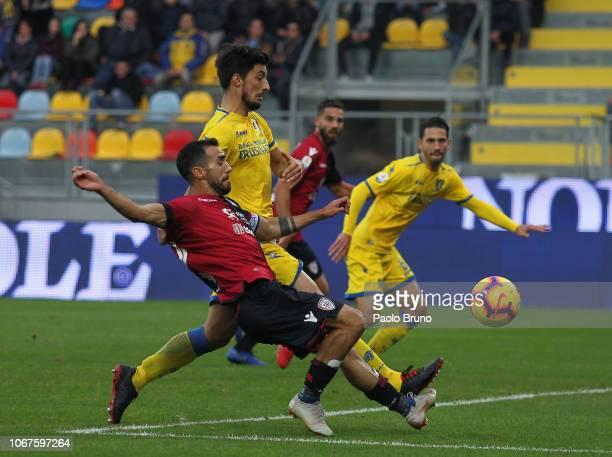 Marco Sau of Cagliari competes for the ball with Lorenzo Ariaudo of Frosinone Calcio during the Serie A match between Frosinone Calcio and Cagliari...