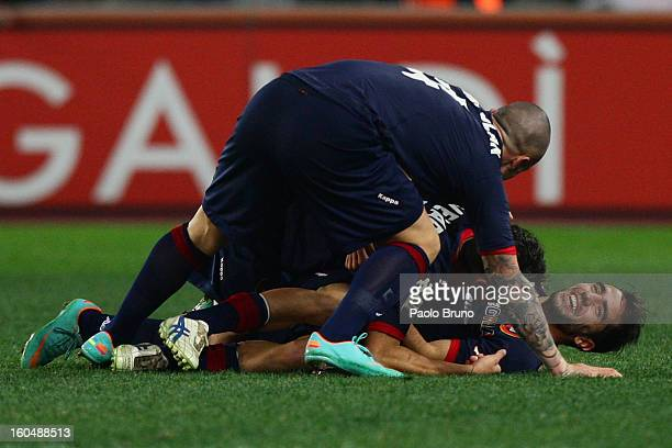 Marco Sau with his teammates of Cagliari Calcio celebrates after scoring the third team's goal during the Serie A match between AS Roma and Cagliari...