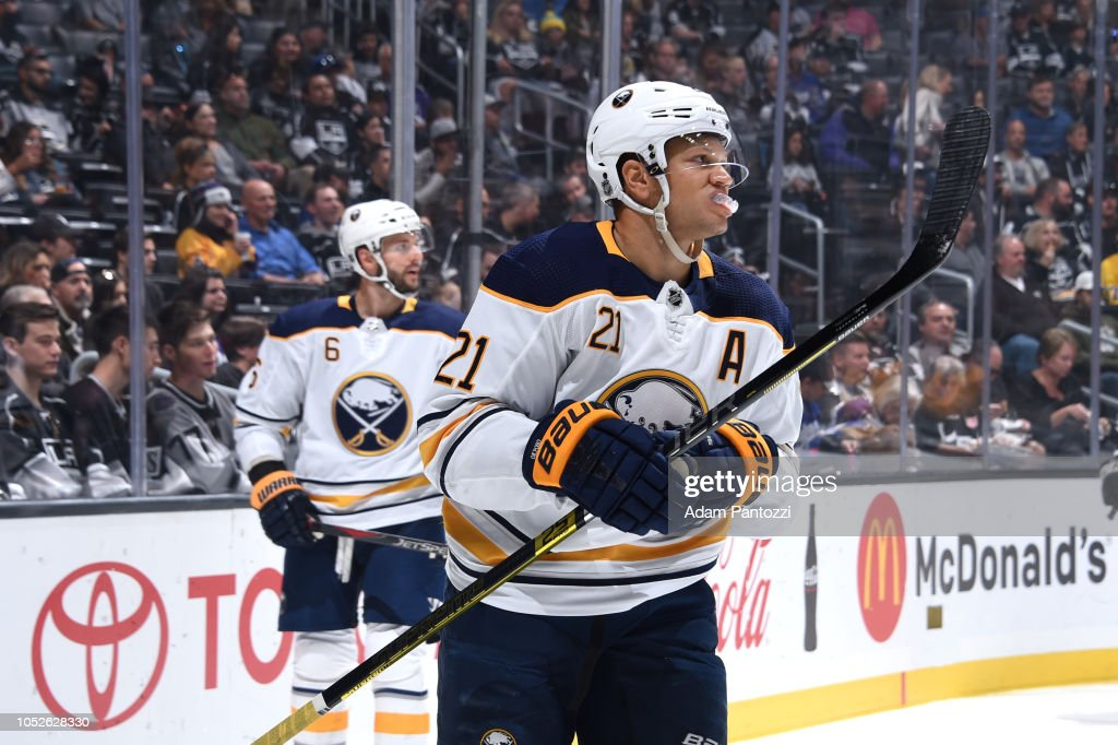 Marco Scandella and Kyle Okposo of the Buffalo Sabres wait