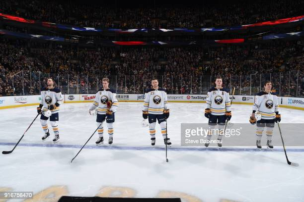 Marco Scandella Casey Nelson Sam Reinhart Jack Eichel and Evan Rodrigues of the Buffalo Sabres stand for the national anthem before the game against...