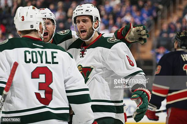 Marco Scandella Nate Prosser and Charlie Coyle of the Minnesota Wild celebrate after a goal in the second period against the New York Rangers at...