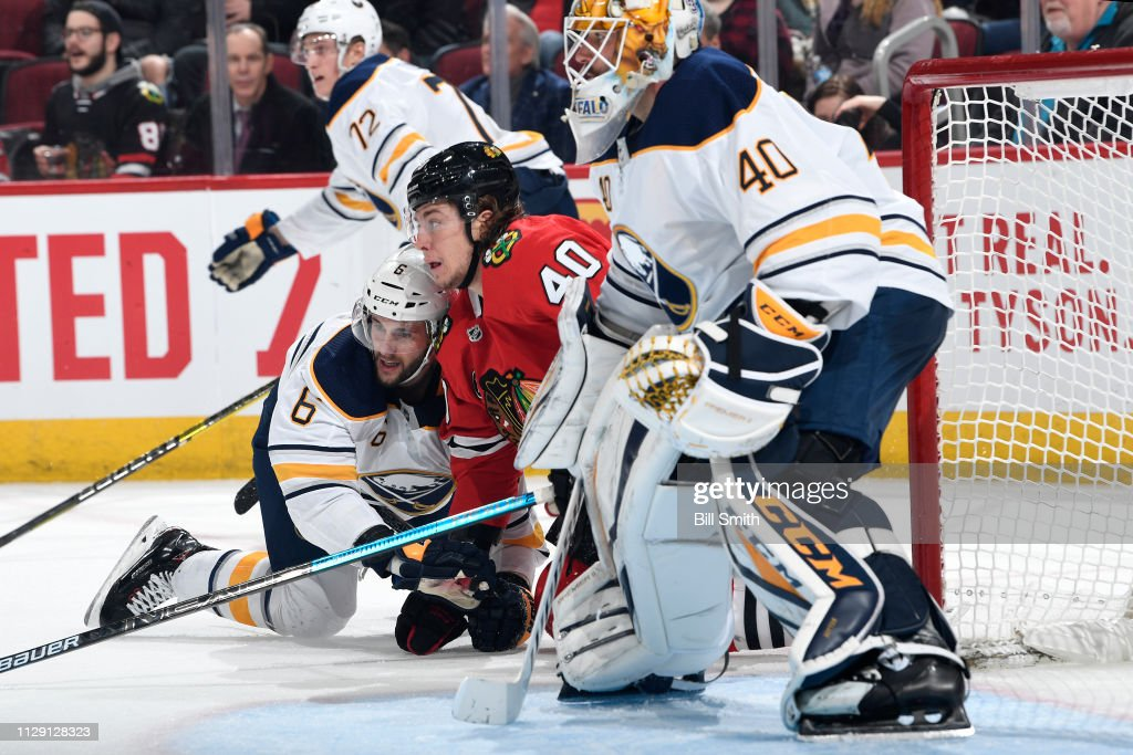Marco Scandella of the Buffalo Sabres and John Hayden of the