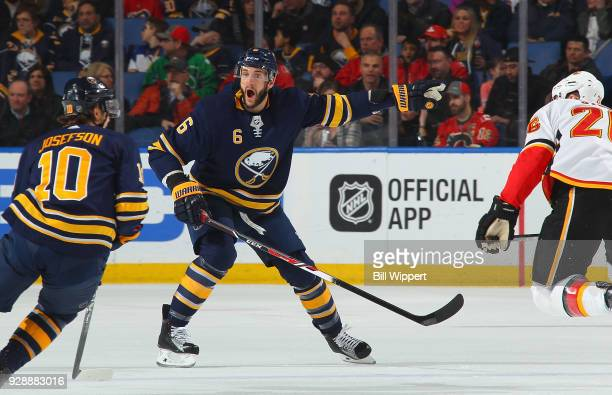 Marco Scandella of the Buffalo Sabres gifs directions to Jacob Josefson during an NHL game against the Calgary Flames on March 7 2018 at KeyBank...