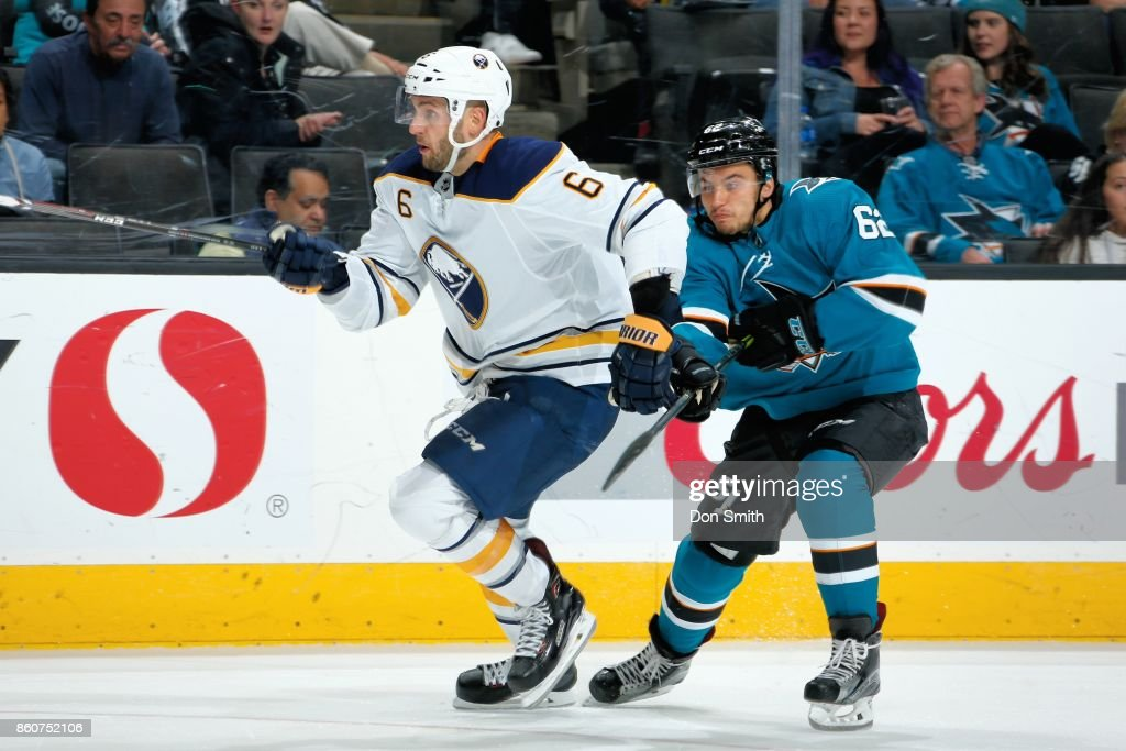 Marco Scandella #6 of the Buffalo Sabres skates against Kevin Labanc #62 of the San Jose Sharks at SAP Center at San Jose on October 12, 2017 in San Jose, California.
