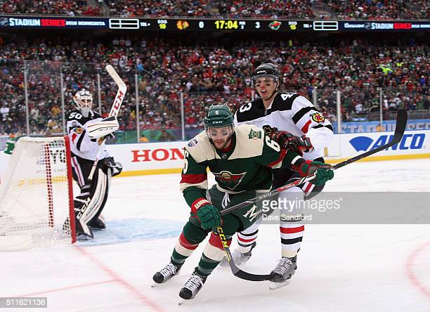 Marco Scandella of the Minnesota Wild and Viktor Svedberg of the Chicago Blackhawks skate after the puck during the second period of the 2016 Coors...