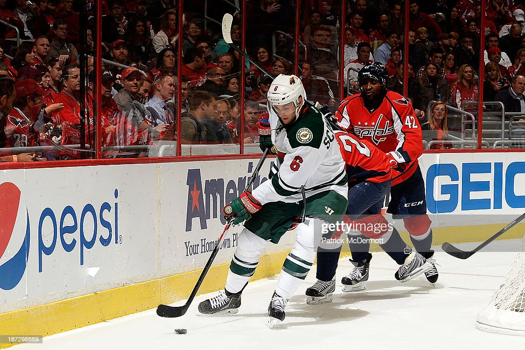 Marco Scandella #6 of the Minnesota Wild brings the puck around the net in the second period during an NHL game against the Washington Capitals at Verizon Center on November 7, 2013 in Washington, DC.