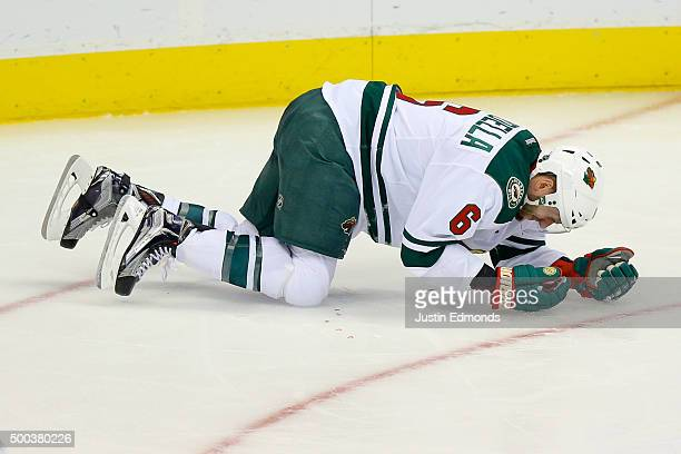 Marco Scandella of the Minnesota Wild falls to the ice bleeding after getting hit with the puck in the face during the third period against the...
