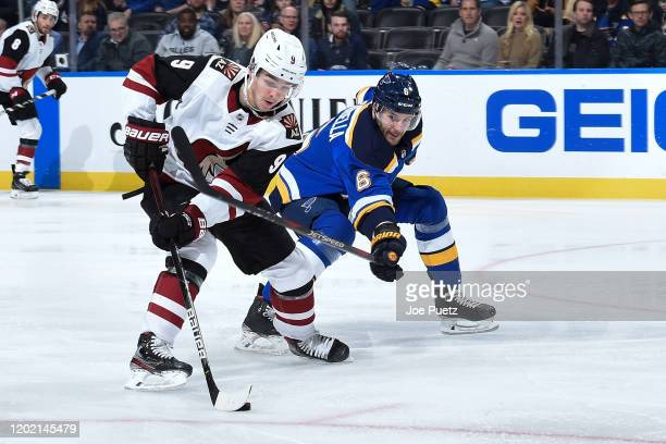 Marco Scandella of the St. Louis Blues defends against Clayton Keller of the Arizona Coyotes at Enterprise Center on February 20, 2020 in St. Louis,...