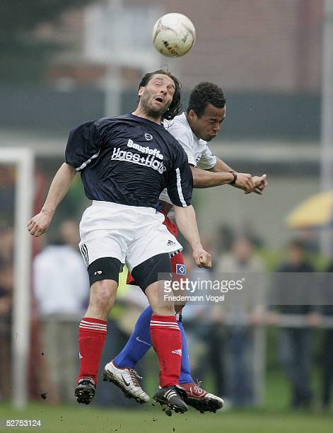 Marco Schabacker of Rellingen and YusufMuro Adyrunmi of Hamburg challenges for the ball during the match between Halstenbek Rellingen and HSV...