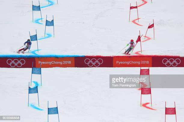 Marco Schwarz of Austria and Donghyun Jung of Republic of Korea compete during the Alpine Team Event 1/8 Finals on day 15 of the PyeongChang 2018...