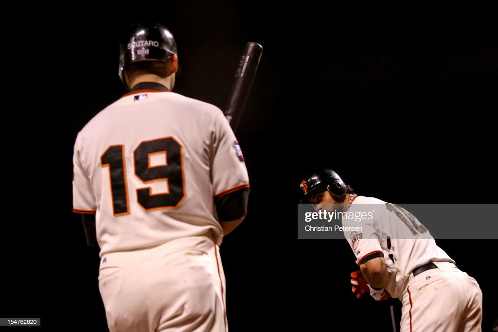 Marco Scutaro #19 and Angel Pagan #16 of the San Francisco Giants look on as they wait to bat against the Detroit Tigers during Game Two of the Major League Baseball World Series at AT&T Park on October 25, 2012 in San Francisco, California.