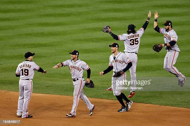 Marco Scutaro of the San Francisco Giants celebrates with teammates Gregor Blanco Hunter Pence Brandon Crawford and Angel Pagan after defeating the...
