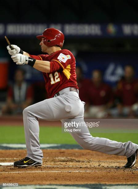 Marco Scutaro of Venezuela lines a single to right field in the second inning against Puerto Rico during day 3 of round 2 of the World Baseball...