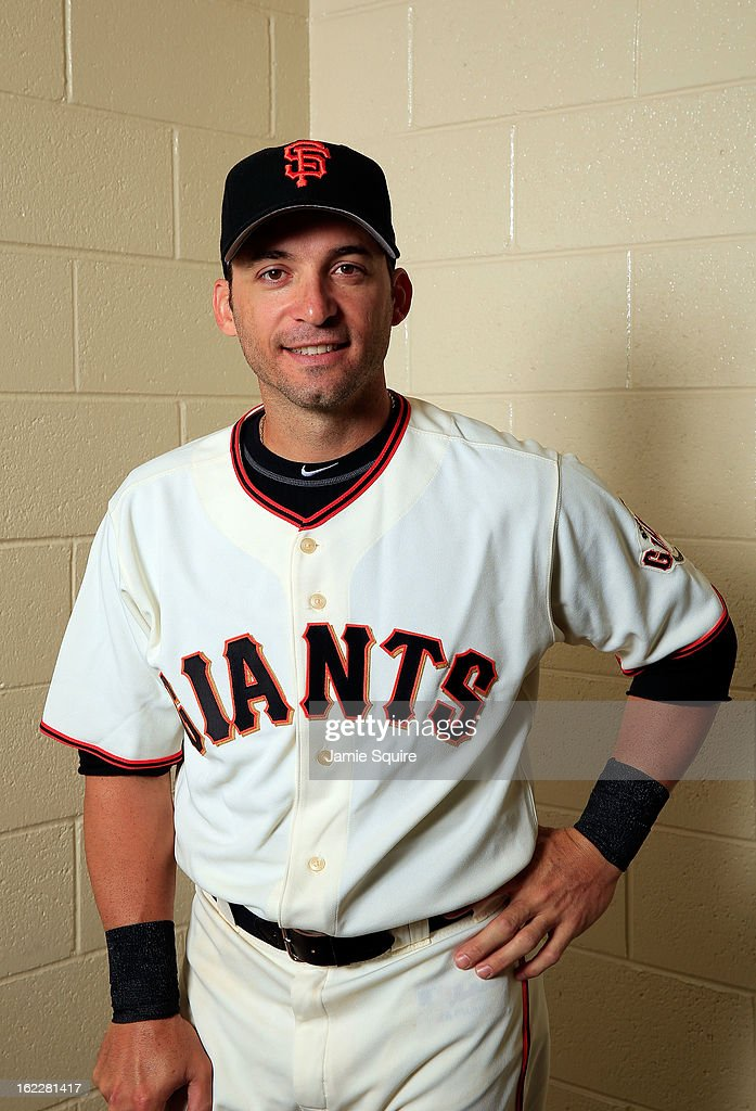 Marco Scutaro #19 poses for a portrait during San Francisco Giants Photo Day on February 20, 2013 in Scottsdale, Arizona.