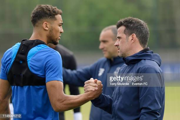 Marco Silva greets Dominic CalvertLewin during the Everton training session at USM Finch Farm on April 25 2019 in Halewood England