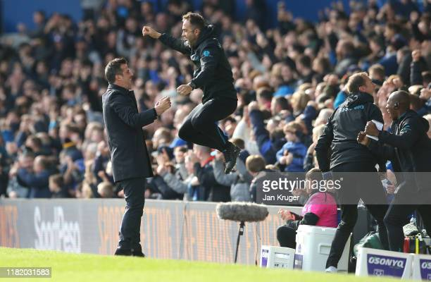 Marco Silva Manager of Everton celebrates with Coaching Staff after Bernard of Everton scores his teams first goal of the match during the Premier...