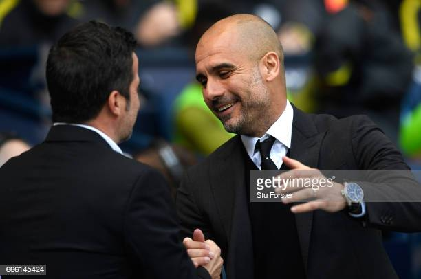 Marco Silva Manager of Hull City and Josep Guardiola Manager of Manchester City embrace prior to the Premier League match between Manchester City and...