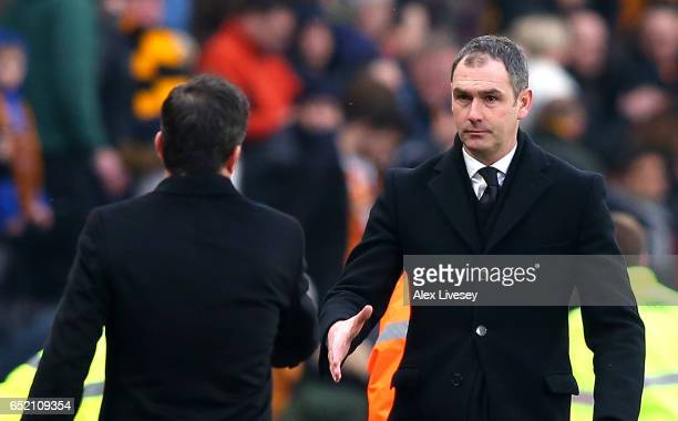Marco Silva Manager of Hull City and Paul Clement Manager of Swansea City shake hands after the Premier League match between Hull City and Swansea...
