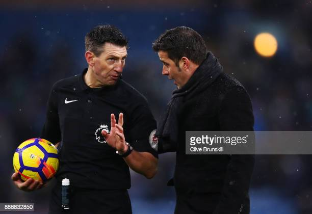 Marco Silva Manager of Watford confronts referee Lee Probert at half time during the Premier League match between Burnley and Watford at Turf Moor on...