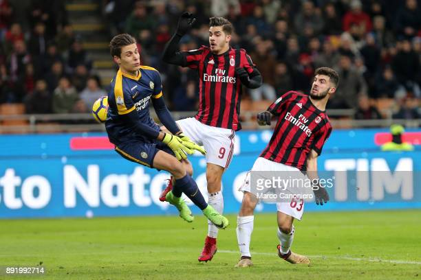 Marco Silvestri of Hellas Verona Fc Andrè Silva and Patrick Cutrone of Ac Milan in action during the Tim Cup football match between AC Milan and...
