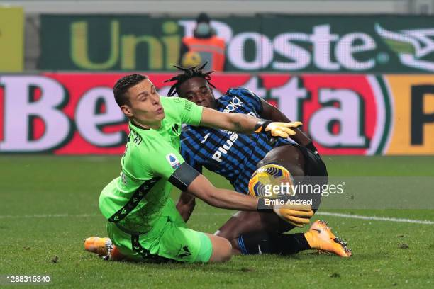Marco Silvestri of Hellas Verona F.C. Saves a shot from Duvan Zapata of Atalanta B.C. During the Serie A match between Atalanta BC and Hellas Verona...