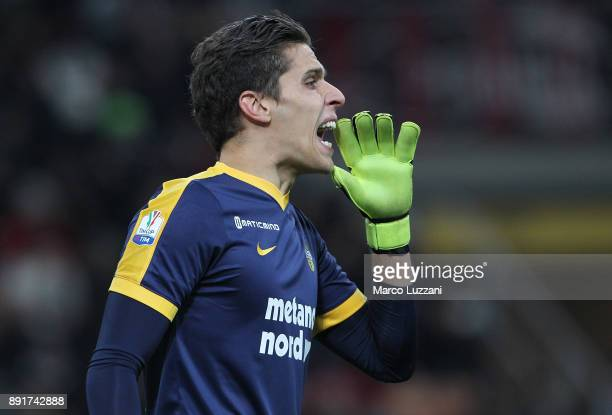 Marco Silvestri of Hellas Verona FC shouts to his teammates during the Tim Cup match between AC Milan and Hellas Verona FC at Stadio Giuseppe Meazza...