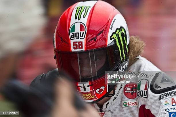 Marco Simoncelli of Italy and San Carlo Honda Gresini arrives at the end of the qualifying practice during the MotoGP of Italy at Mugello Circuit on...