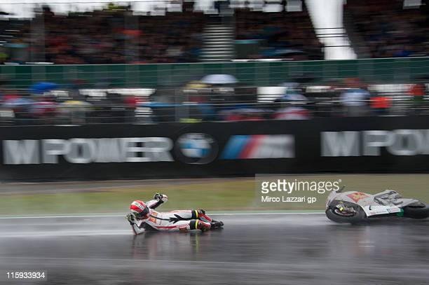 Marco Simoncelli of Italy and San Carlo Honda Gresini crashed out during the MotoGP race of MotoGp Of Great Britain at Silverstone Circuit on June 12...