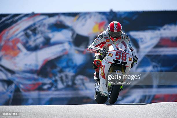 Marco Simoncelli of Italy and San Carlo Honda Gresini heads down a straight during the second free practice of US Grand Prix at Mazda Raceway Laguna...