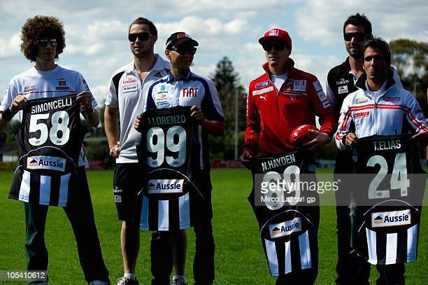 Marco Simoncelli of Italy and San Carlo Honda Gresini Jorge Lorenzo of Spain and Fiat Yamaha Team Nicky Hayden of USA and Ducati Marlboro Team Toni...
