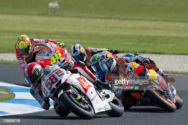 Marco Simoncelli of Italy and San Carlo Honda Gresini leads the field during the MotoGP race of the Australian MotoGP which is round 16 of the MotoGP...