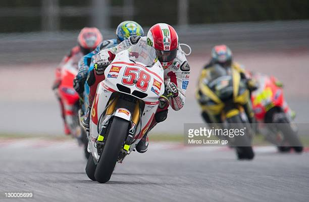 Marco Simoncelli of Italy and San Carlo Honda Gresini leads the field during the MotoGP race of MotoGP of Malaysia at Sepang Circuit on October 23...