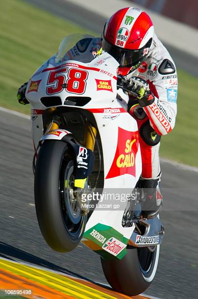 Marco Simoncelli of Italy and San Carlo Honda Gresini lifts the front wheel during the third free practice of MotoGP of Valencia at Ricardo Tormo...