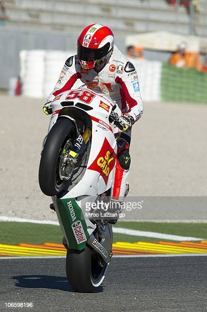 Marco Simoncelli of Italy and San Carlo Honda Gresini lifts the front wheel during the qualifying practice of MotoGP of Valencia at Ricardo Tormo...