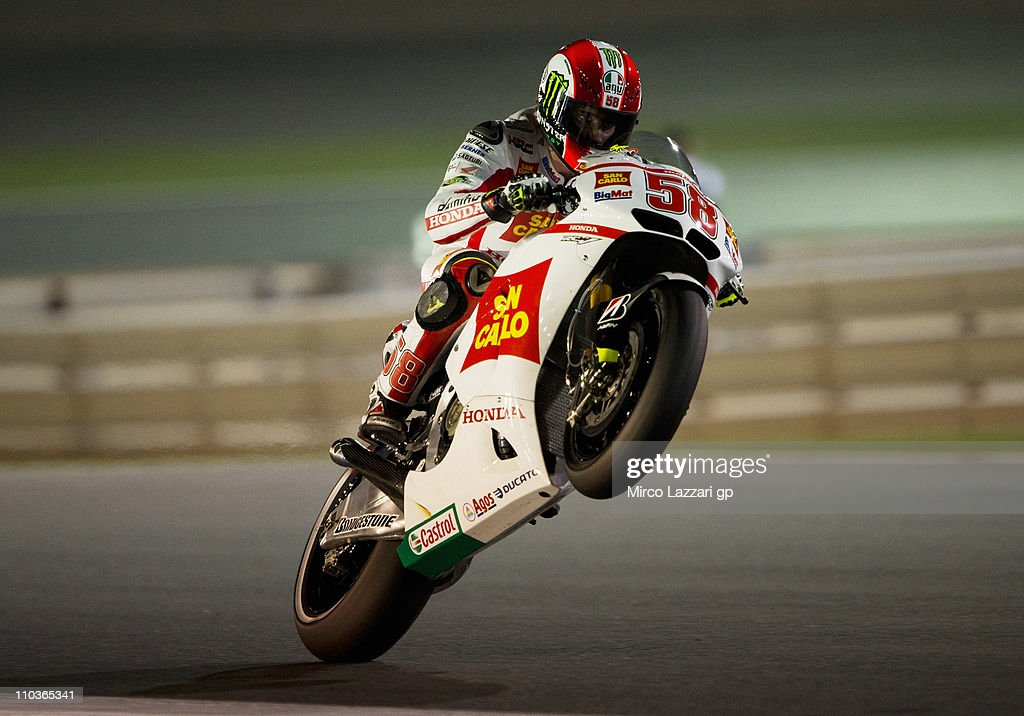 Marco Simoncelli of Italy and San Carlo Honda Gresini lifts the front wheel during the free practice of Doha GP at Losail Circuit on March 17, 2011 in Doha, Qatar.