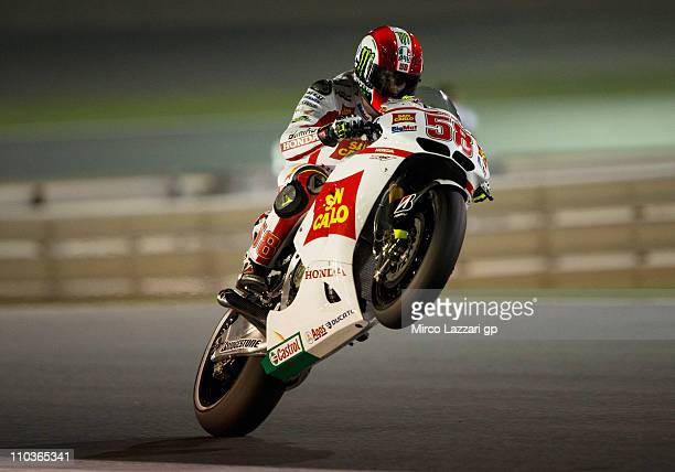 Marco Simoncelli of Italy and San Carlo Honda Gresini lifts the front wheel during the free practice of Doha GP at Losail Circuit on March 17 2011 in...