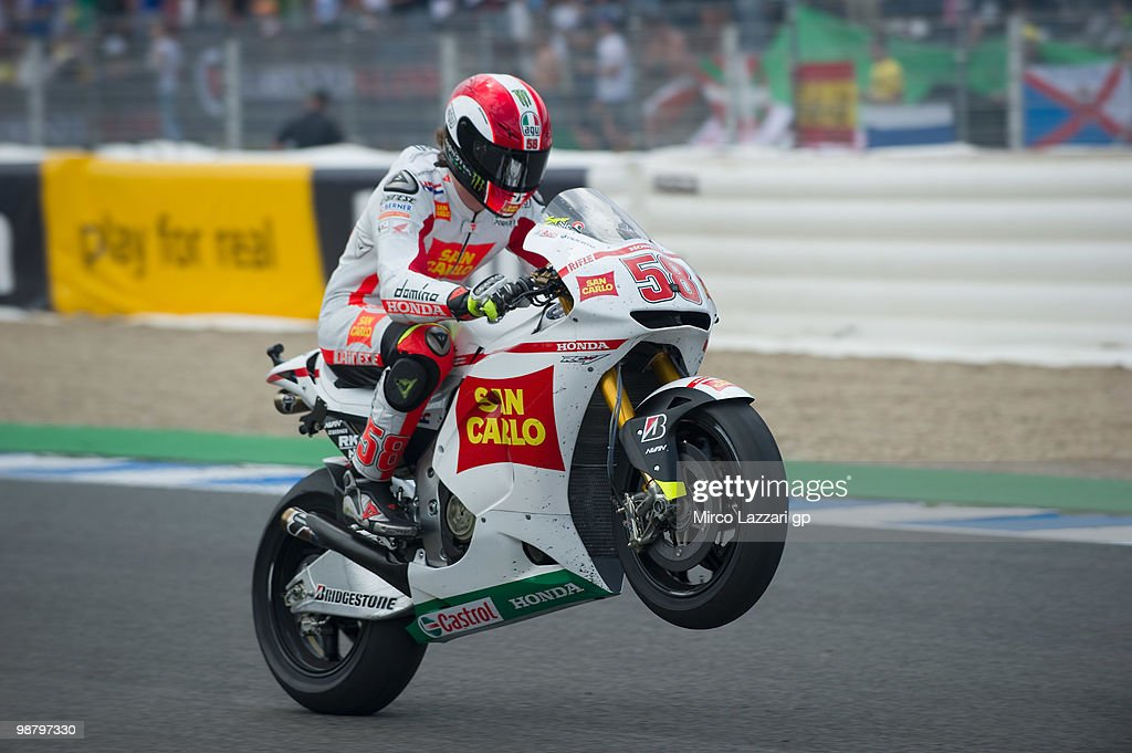Marco Simoncelli of Italy and San Carlo Honda Gresini lifts the front wheel at the end of the MotoGP race at Circuito de Jerez on May 2, 2010 in Jerez de la Frontera, Spain.