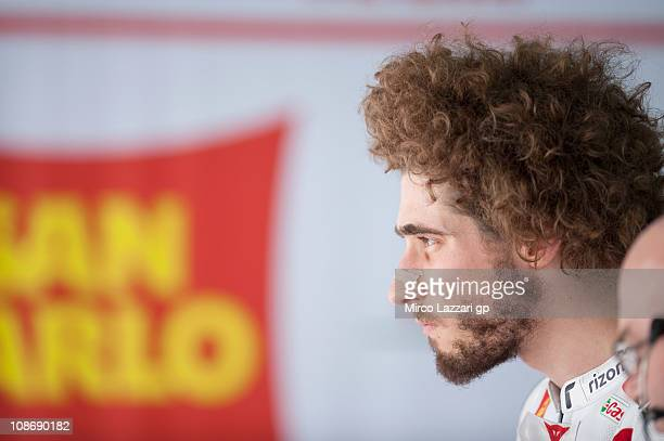 Marco Simoncelli of Italy and San Carlo Honda Gresini looks on in box during the first session of testing at Sepang Circuit on February 1 2011 in...