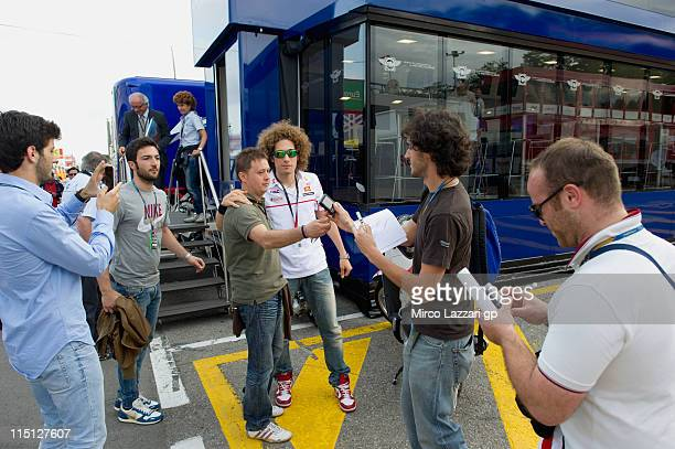 Marco Simoncelli of Italy and San Carlo Honda Gresini poses for fans after the practice of MotoGp Of Catalunya at Circuit de Catalunya on June 3 2011...