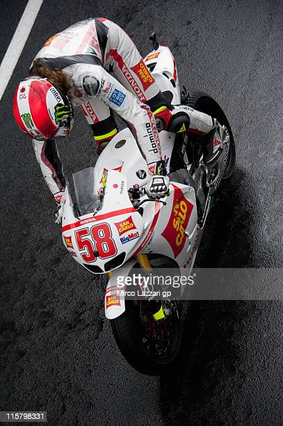 Marco Simoncelli of Italy and San Carlo Honda Gresini rides in pit during the free practice of MotoGP of Great Britain at Silverstone Circuit on June...