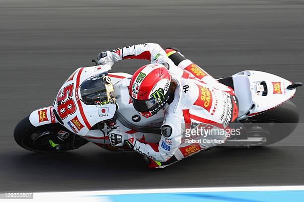 Marco Simoncelli of Italy rides the San Carlo Honda Gresini Honda during the Australian MotoGP which is round 16 of the MotoGP World Championship at...