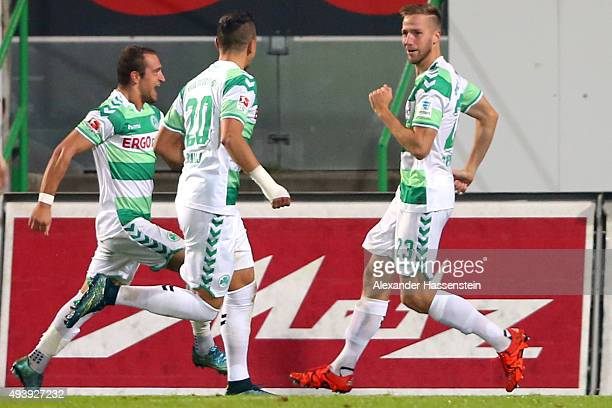 Marco Stiepermann of Fuerth celebrstes scoring the opening goal with his team mates Robert Zulj and Vaton Berisha during the second Bundesliga match...