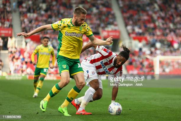 Marco Stiepermann of Norwich City and Ashley Williams of Stoke City during the Sky Bet Championship match between Stoke City and Norwich City at...