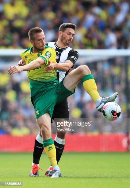 Marco Stiepermann of Norwich City and Fabian Schar of Newcastle United compete for the ball during the Premier League match between Norwich City and...