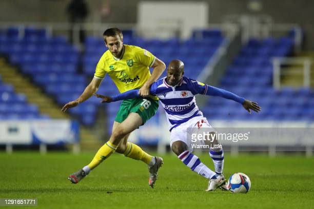Marco Stiepermann of Norwich City battles for possession with Sone Aluko of Reading during the Sky Bet Championship match between Reading and Norwich...