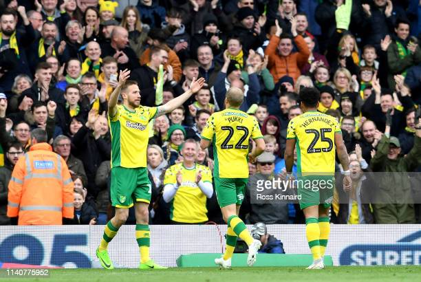 Marco Stiepermann of Norwich City celebrates after scoring his team's second goal with his team mates during the Sky bet Championship match between...