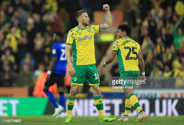 Marco Stiepermann of Norwich City celebrates with his teammates after he scores his sides first goal during the Sky Bet Championship match between...