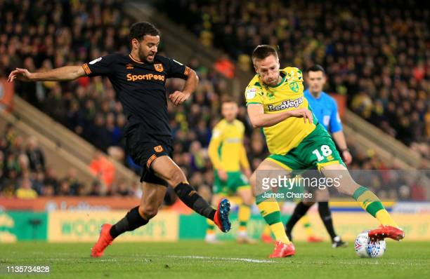 Marco Stiepermann of Norwich City is challenged by Kevin Stewart of Hull City during the Sky Bet Championship match between Norwich City and Hull...