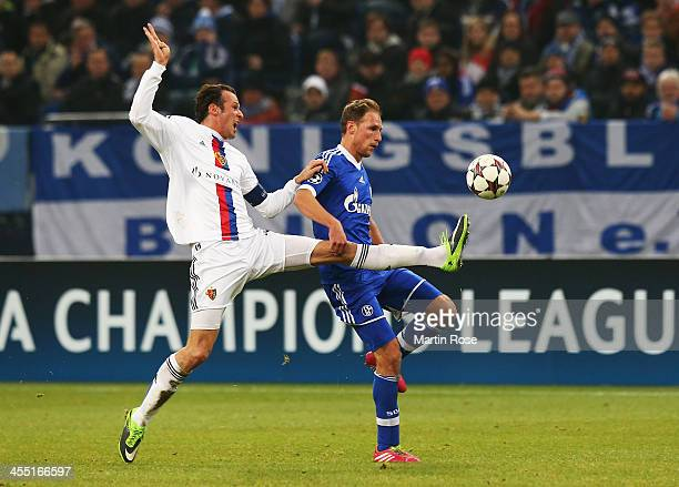 Marco Streller of Basel and Benedikt Howedes of Schalke challenge for the ball during the UEFA Champions League Group E match between FC Schalke 04...