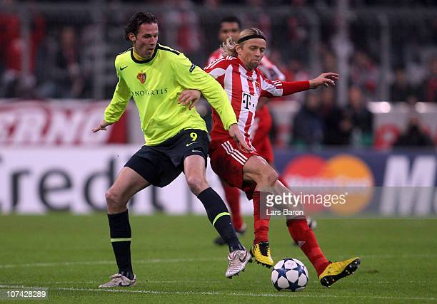 Marco Streller of Basel is challenged by Anatoliy Tymoshchuk of Muenchen during the UEFA Champions League group E match between FC Bayern Muenchen...